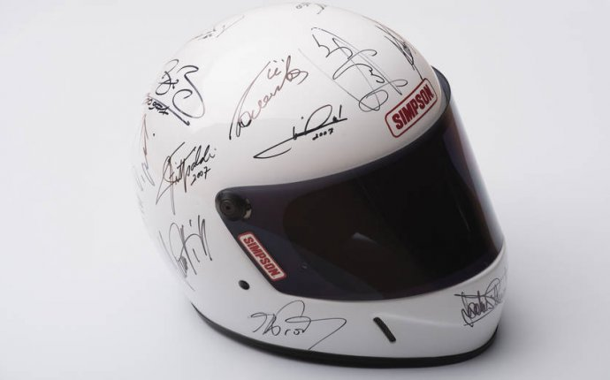 Incredible F1 champions autographed helmet to help children s